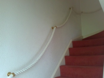 An example of the use of 32mm 100% Cotton Rope with Brass Banister Brackets as a handrail up a flight of stairs.